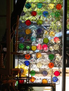 I've been cutting out the bottoms of wine bottles and making lights out of the bottles...but this is a great idea to recycle those wine bottles WOW!