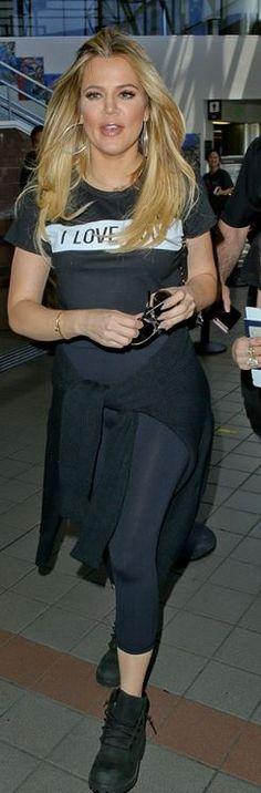 Khloe Kardashian: Bracelet – Cartier  Purse – Fendi  Shoes – Timberland  shirt – Lovers + Friends