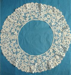 My choice for best lace from the 8/11/2013 Ebay Alerts.  Probably a bertha collar of Bruges Bloemwerk, although a little atypical.