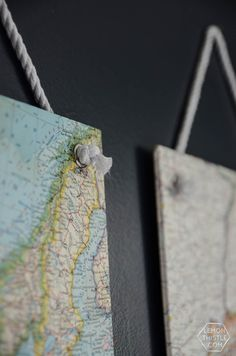 I love how they're hung with grommets! So classy. DIY Vintage Maps Wall Hangings