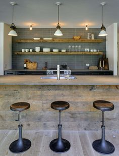 Kitchen Design Idea – 19 Examples Of Open Shelving   Long wood floating shelves mixed with a concrete countertop creates a rustic yet contemporary feel.