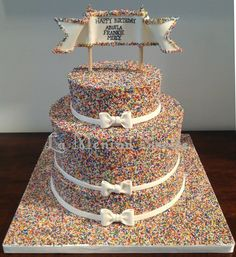 Non-pareils triple birthday cake. Awesome tutorial on Half Baked TheCake Blog.