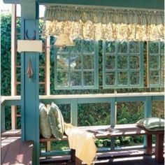 Great idea! Use old windows on a porch...bring a little of the inside outside!