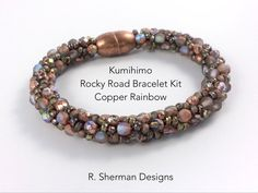 Complete kit contains nearly everything you need to create the Kumihimo Rocky Road Bracelet in Etched Copper Rainbow, and featuring Fire Polished beads  Techniques used: 8 warp cord Kongo Gumi (beaded round braid) Braiding around a core. Prior experience with Kumihimo braiding with beads is essential, but if you havent previously used a core in your braiding, the included pattern provides instruction. Its easy!  Kit includes: - Complete tutorial with bead loading pattern, tips, and finishing…