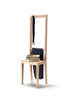 Alfred - this unusual chair is designed for clothes and small items to find their own dedicated space. The tall back rest enables you to hang all coats, even long ones. The slight depression enables you to hang up a belt, scarf or purse while the additional bar below can be used for hanging even more clothes. The seat can be used as a shelf for minor items -- the dent at the back prevents clothes from creasing. - FormAdore.com