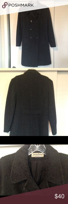 Jonathan Michael Coat Very warm greyish black coat by Jonathan Michael. Got this from a friend who had taken all the tags off, so my best guess is it's wool or a wool blend, but with a nice lining that would protect those who get itchy with wool. I'm also guessing it's an 8 or 10. Hits right below the knee. Very cute, but I have no use for it on the CA coast. Nice used condition. Has a couple small tares in the inside at the bottom, which I had never noticed. Jackets & Coats