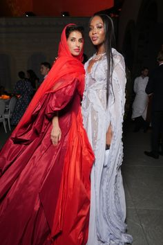 Princess Deena Aljuhani Abdulaziz in Zac Posen with Naomi Campbell in Ralph and Russo.