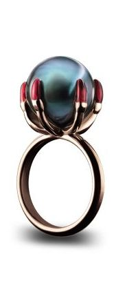 "BALLCRUSHER RING Tahitian pearl held in a five fingered claw with red lacquered nails sitting on a ""D"" section shank in 18ct red gold"
