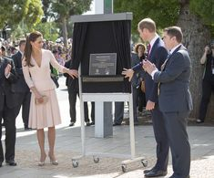 Catherine, Duchess of Cambridge and Prince William, Duke of Cambridge unveil a plaque to commemorate the naming of 'Prince Georhge Plaza' on April 23, 2014 in Adelaide, Australia.
