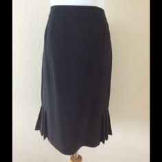 Black straight skirt with side pleats at bottom This is a new skirt, fully lined, soft rayon, zipper. No tags. It fits woman size 10 waste about 30 inches, length to the knee, great skirt for office work or every day wear with any top, nice feminine detail on bottom of skirt see photos Skirts Pencil
