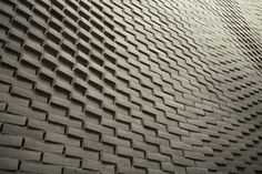 Gallery of This Hand-Laid Brick Feature Wall Was Inspired by Soundwaves in Water - 8