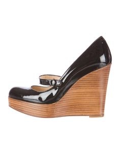 Black Christian Louboutin patent leather Mary Jane wedges with stacked wedge heels and platforms and strap across foot with snap closure. Includes box and dust bag.