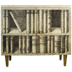 For Sale on 1stdibs - A lovely cabinet designed and manufactured by Piero Fornasetti in the sixties. The two doors of the front section are decorated with a trompe l'oeil double