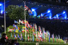 Flags of the world fly in London  Flags of the 205 competing nations are planted by athletes on the replica of Glastonbury Tor.