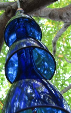 Wine bottle top wind chimes. No tutorial, but enough pins that show how to cut the bottles with acetone, yarn and fire. All the crafters can figure this one out