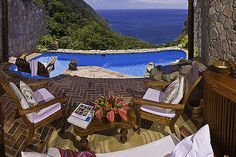 $400/night Ladera resort in St. Lucia, West Indies, is so private that it has literally removed the fourth wall from the suites — each is open to the ocean breeze and the sound of the surf and the birds.
