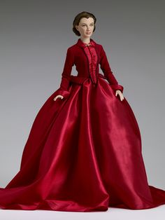 "$224.99 - Gone With the Wind -Scarlett - Tonner Doll Company Dressed Doll  Face includes hand-painted details  Fine quality vinyl and hard plastic  Vivien Leigh portrait sculpt  16"" Tyler bending wrist body  Tyler skin tone  Green painted eyes  Brown rooted saran hair  Red dress with black trim and red beads and a gold brooch at the collar  Bronze hair decoration  White petticoat  Nude pantyhose with attached panties  Red taffeta shoes to match  LE 300"