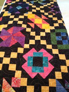 Batik Quilt... love these bright colors on black.