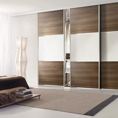 Modern closet door with options sliding closet doors wearing a brown color and white to allow opening and closing the door In order to be more easily Mirrored Bifold Closet Doors, Modern Closet Doors, Modern Sliding Doors, Sliding Closet Doors, Double Doors, Sliding Door Wardrobe Designs, Sliding Door Design, Closet Door Alternative, Closet Door Makeover