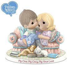 A FIRST! Limited-edition handcrafted Precious Moments® bisque porcelain figurine honors true love with two genuine Swarovski® crystal hearts.