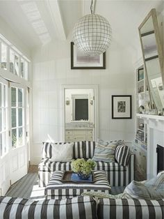 Cozy den. (maybe with solid couch but striped pillows)