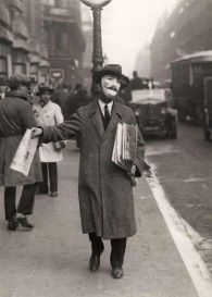 1929: Newspaper seller, Paris, via Retronaut