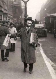 1929: Newspaper seller, Paris, via Retronaut