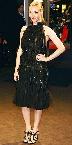 Amanda Seyfried in a Nina Ricci halter dress with sheer slivers, sparkles and a bare back at the International Film Festival in Berlin