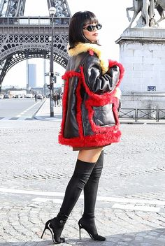 Even when it's cold out Rihanna doesn't stray from her go-to black Manolo Blahnik Chaos Sandals, worn here with a bold coat and knee-high socks in Paris.