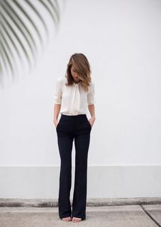 The ultimate work attire that is appropriate for all desk jobs: Flared pants with flowy top! via The Style Bungalow -http://cosmopolitan.in