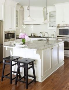 Beautiful white kitchen design with white shaker kitchen cabinets, black granite, counter tops, glossy white subway tiles backsplash, white ...