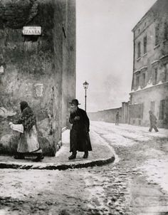 Roman Vishniac, Cracow 1938      Repeating elements, sense of motion (the three people moving in the same direction).  It's fascinating to me that this is a vertical shot. . .seems like that is counter-intuitive in trying to fill the frame, but it works, showing the ice in the foreground and the street marker on the building.  The hand on the old man's chest is perfect and poignant.  Bad weather = good pictures!!