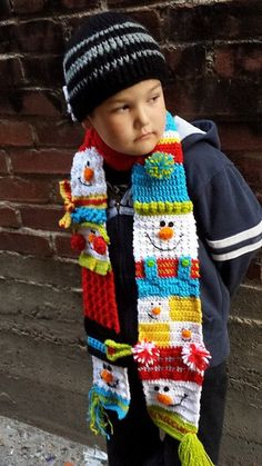 "Size: 5"" X 70"" or longer.  It can also be made longer if desired.  Skill Level: Intermediate Beginner.  Click here to order this cute PDF crochet pattern: http://www.maggiescrochet.com/products/snappy-sampler-snowman-scarf-crochet-pattern-download"