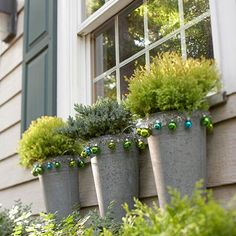 galvanized tins with greenery, trimmed with blue and green small glass balls. Fresh looking.