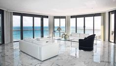I love the look of this living room. I think the sleek design is perfect for its ocean-side location. I especially like the marble flooring that adds a touch of something different while maintaining the simplicity of the room. White Tiles, White Marble, Black Tiles, Floor Design, Tile Design, Design Room, Flooring Ideas, Glazed Walls, Travertine