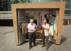 Mayor of London Boris Johnson (L)  stands with designer Wayne Hemingway   at a 'pop-up-shop' outside City Hall on July 2, 2009 in London, England. The 'KioskKiosk' portable shop design will provide rent free retail space for people with creative products to sell. Dozens of fledgling businesses will use the space over the next few weeks next to City Hall near Tower Bridge in Central London.
