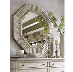 The octagonal mirror features carved lines which are softened with a light finish giving the mirror a casually elegant look. Pair with a console table or buffet to create a statement.