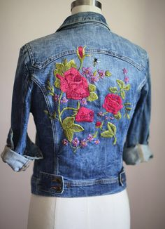"""Another take on floral embroidery on a denim jacket. An explosion of bright florals, predominantly roses. Even a lone bee. Hues fit perfectly with the denim wash. Definitely a """"notice me"""" garment. And lots of fun. Style Planet #embroidered denim #embroidered jean jacket"""