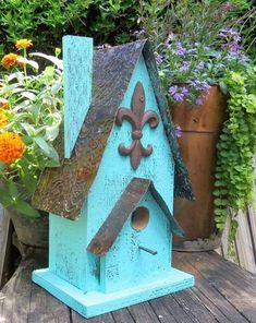 Reclaimed Barn Wood and Tin Birdhouse attracts wrens, finches, chickadees, nuthatches and others to nest. Rustic bird house with iron fleur-de-lis and aged tin roof