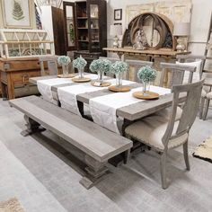 We have another 7' table in the shop. This one is a distressed gray. One of the good things with this is you can pick if you want some chairs with a bench or all chairs or you can even have the big upholstered captains chairs. #farmhouse #farmhousedecor #fixerupper #fixerupperstyle #hgtv #thegildedsparrow