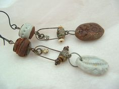 Vintajia Adornments ~ Greer McNeill  mismatched earrings with white and rust coated polymer clay. salvaged pewter pail, rhinestone, vintage tin bead caps ♥
