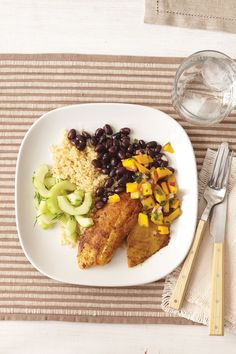 Tilapia with Quinoa and Mango Salsa recipe from an ALL YOU reader. Healthy and simple to make!