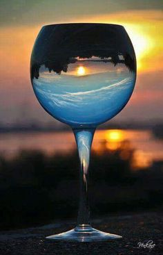 Having a glass of wine and watching the sunset