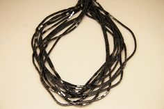 1strand  natural hematite plain stick sized 2 by 4mm by 3yes