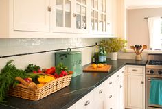 Fantastic kitchen with walls painted Benjamin Moore Simply White alongside white cabinets with nickel hardware and soapstone countertops below a subway tile backsplash with black pencil tile accent. Black Backsplash, Wood Backsplash, Herringbone Backsplash, Backsplash Ideas, 1920s Kitchen, Vintage Kitchen, Soapstone Countertops, Kitchen Countertops, Kitchen Backslash