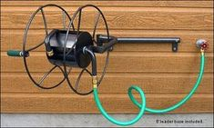 """$115 Hose Reel - Wall-Mount Swivel hose reel (see """"garden"""" page for more hose reels...) swivels up to 180 degrees makes it EZ to unwind from any direction. Rust-resistant powder-coated steel 18"""" dia reel + 20""""w mount bracket built to last. Grippy texture-coated spool handle. Reel holds 100' of 5/8"""" hose, 75' of 3/4"""" lifetime hose. incl 5' leader hose, brass fittings to connect unit to std 3/4"""" faucet. Reel can be lifted off mount w/o removing main hose bracket for winter storage. hdwr incl"""