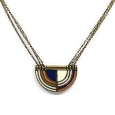 Make a statement with this deco semi-circle necklace