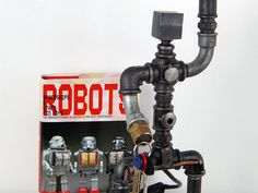 Buy an amazing Robot lamp made of industrial parts Industrial Interior Design, Industrial Interiors, Modern Industrial, What Is Steampunk, Steampunk Lamp, Metal Pipe, Plumbing Pipe, Forced Labor, Neo Victorian