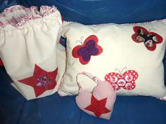 The reverse side of a set of personalised presents - pillow, gym bag and lavender heart.