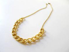 DIY 5 minute gold chain necklace  It's just 4 jump rings, a clasp, and about 7 inches of large chain, and 2 7-inch pieces of thin chain. Open up the rings, connect all the pieces, et voila!